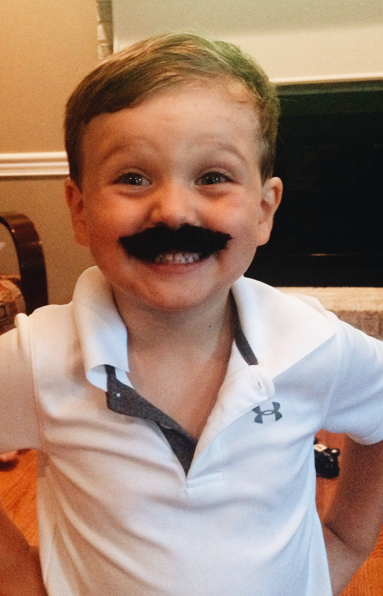Child Smiling with Mustache